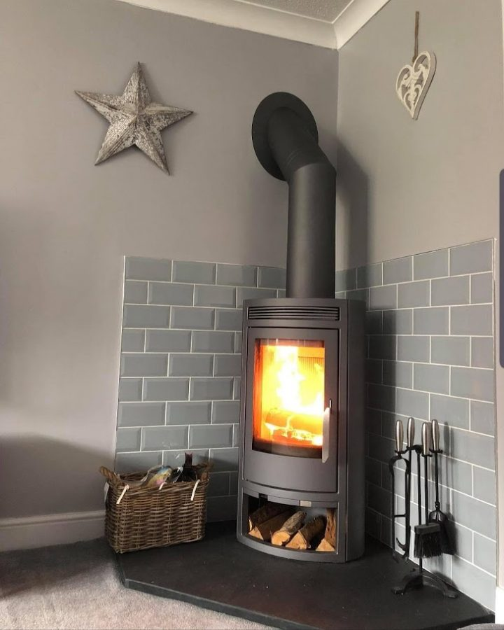 A corner stove on one of our bespoke five-sided pentagonal slate hearths