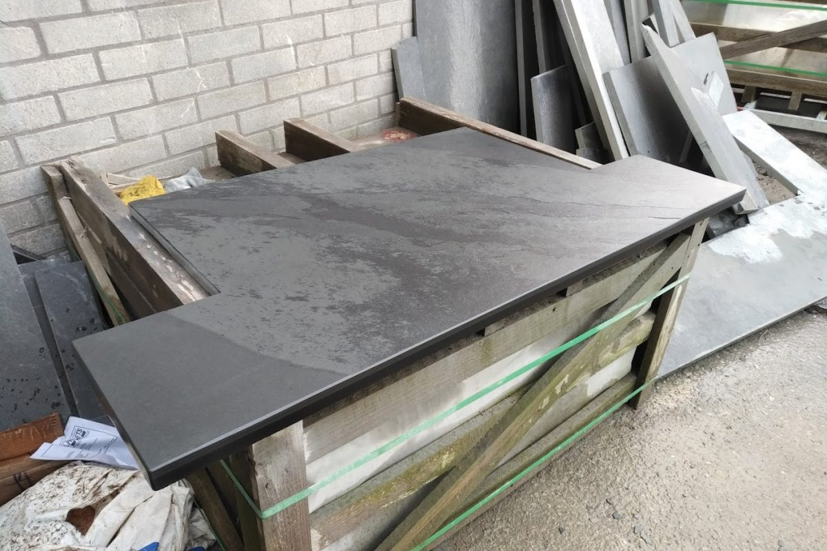 Bespoke T-shaped slate hearth at the end of preparation