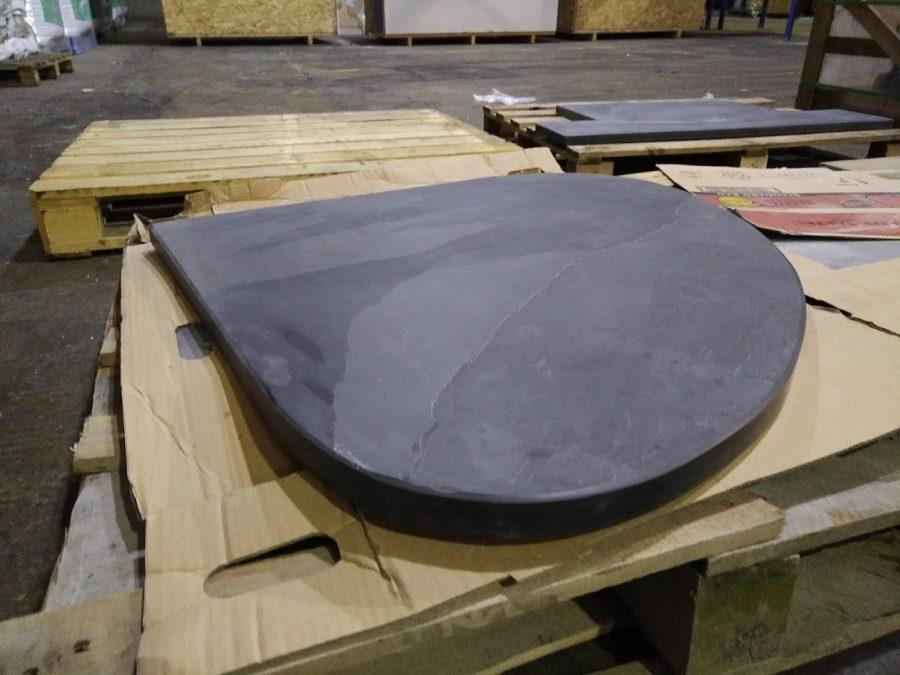 Bespoke thick teardrop shaped slate hearth ready to go