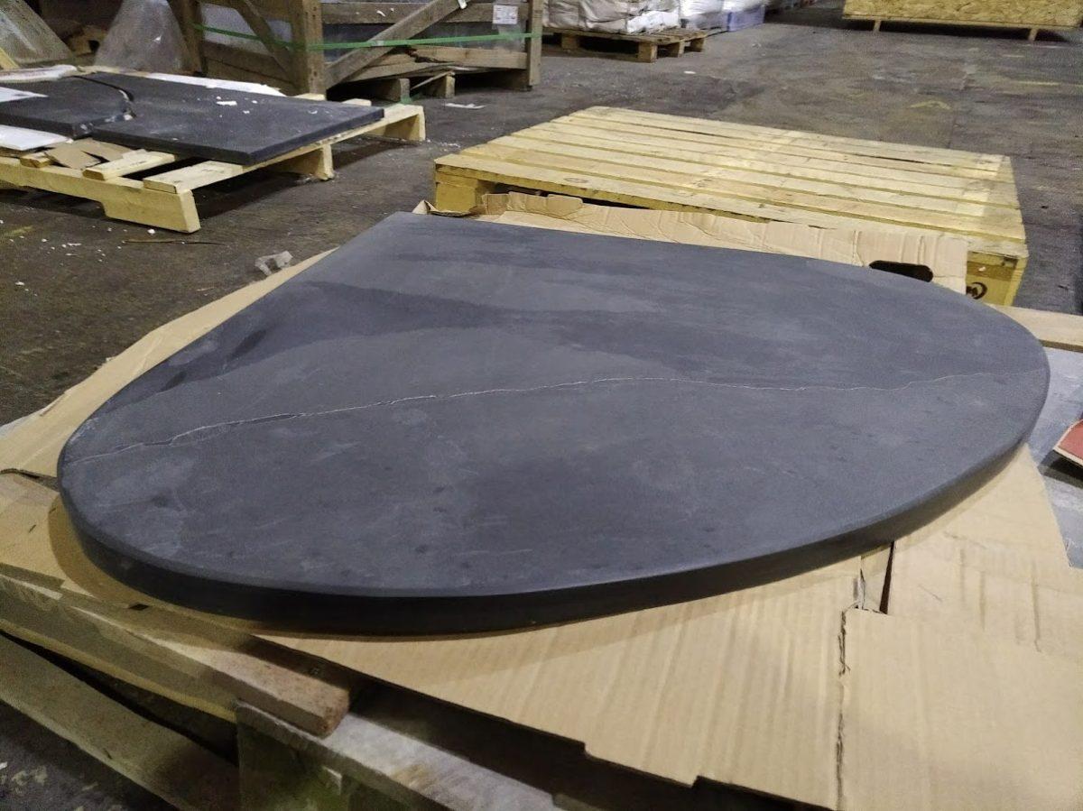 Wide teardrop shaped bespoke slate hearth for a corner
