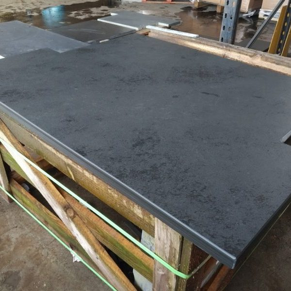 A wide T-shaped slate hearth cut and ready for delivery in February