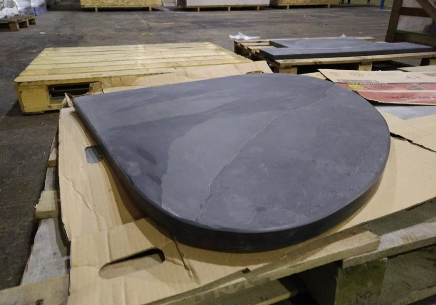 Bespoke thick teardrop shaped slate hearth ready to go