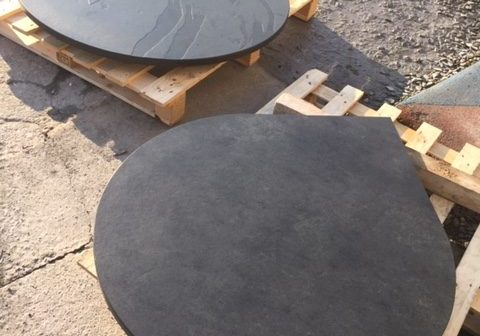 Circular slate hearth with pointy bit for a corner