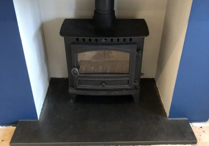 Fireplace with one of our made-to-measure T-shaped slate hearths