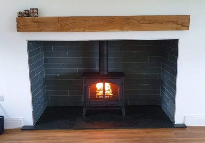Perfect fitting made-to-measure slate hearth finishing off this stove and fireplace