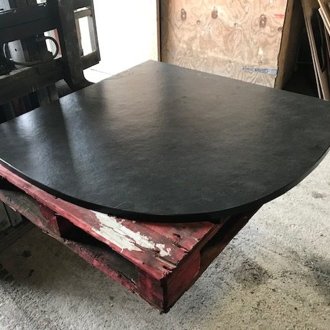 Polished curved corner slate hearth ready for delivery