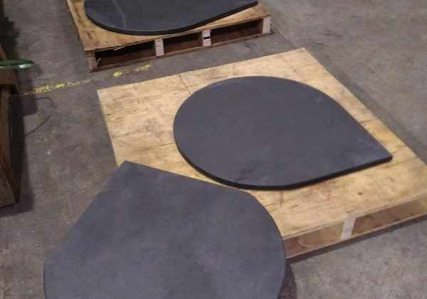 Three bespoke rounded circular slate hearths with right angles for a corner
