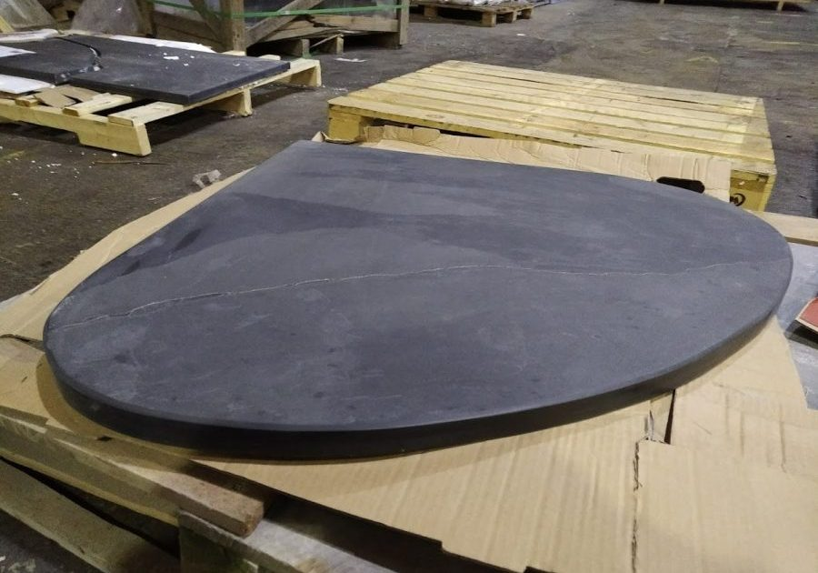 Wide teardrop shaped bespoke slate hearth for a corner